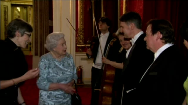 queen hosts reception for the london symphony orchestra audience applauding / queen applauding / queen standing and greeting conductor / queen along... - london symphony orchestra stock videos & royalty-free footage