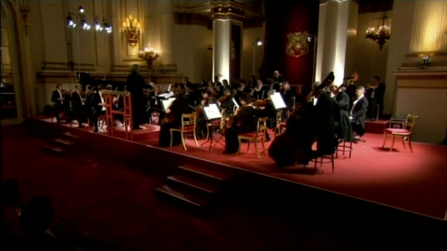 queen hosts reception for the london symphony orchestra **music heard sot** orchestra performing on stage / audience listening - london symphony orchestra stock videos & royalty-free footage