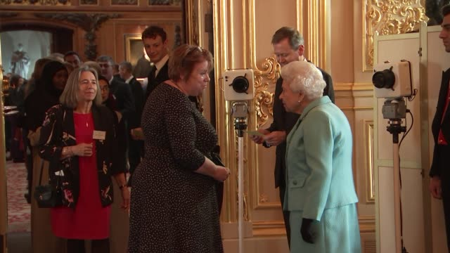 queen hosts reception for the national council for voluntary organisations at windsor castle; england: berkshire: windsor: windsor castle: int guests... - berkshire england stock videos & royalty-free footage