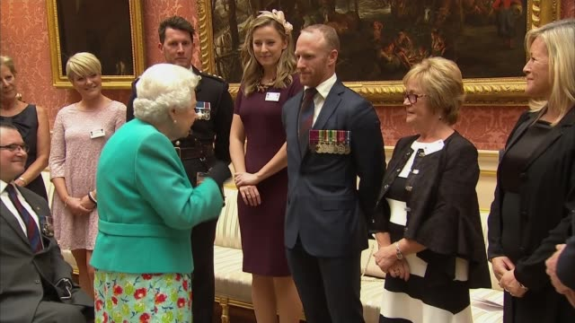 queen hosts vc and gc association reception england london buckingham palace prince michael of kent chatting with people at reception / queen... - prinz michael von kent stock-videos und b-roll-filmmaterial