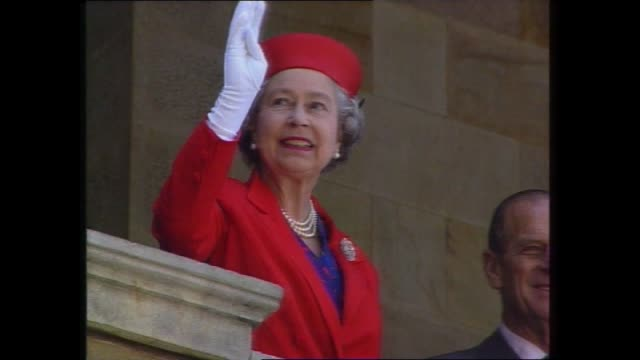 reports / queen in adelaide with people vs / queen in red / vs queen prince phillip greeting the crowds / file yesterday keating puts arm around the... - elizabeth ii stock videos & royalty-free footage