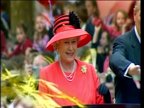 queen in pink and black outfit at golden jubilee celebrations waving to crowds from car with prince philip london; 04 jun 03 - 2000s style stock videos & royalty-free footage