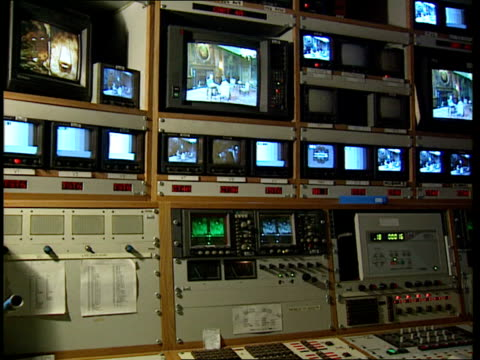 queen; itn gir: itn master control room: bank of monitors & equipment cms screen showing queen's broadcast - television show stock videos & royalty-free footage