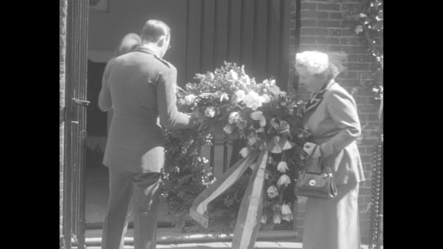 queen juliana and prince bernhard of the netherlands arrive at george washington's tomb in virginia / military official holds wreath / prince removes... - george washington portrait stock videos and b-roll footage