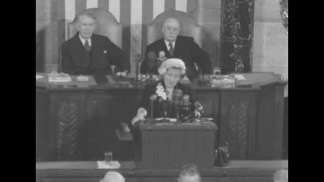 queen juliana standing at rostrum on podium in house chamber speaking vicepresident alben barkley senate president sitting behind her on her right... - sam rayburn video stock e b–roll