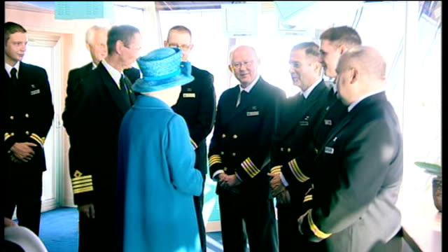 vídeos de stock, filmes e b-roll de queen launches queen elizabeth cruise ship england hampshire southampton throughout** queen elizabeth ii meeting crew members as military band plays... - 2010