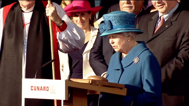 Queen launches Queen Elizabeth cruise ship Southampton EXT Cruise ship 'Queen Elizabeth' at dockside with military band playing fanfare SOT Queen...