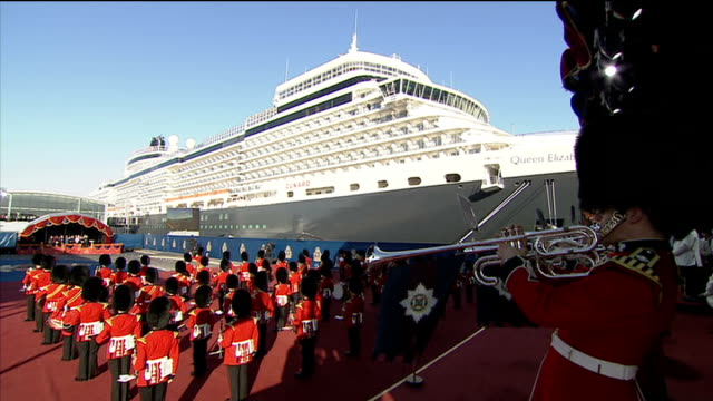stockvideo's en b-roll-footage met queen launches queen elizabeth cruise ship ext car carrying queen elizabeth ii arrives / queen out of car and up small steps where she stands with... - lesley garrett