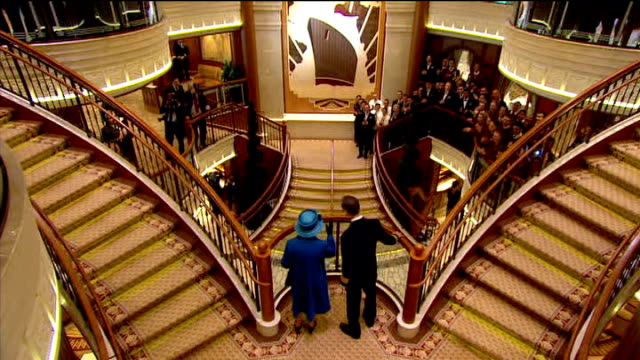 vídeos de stock, filmes e b-roll de queen launches queen elizabeth cruise ship queen elizabeth ii applauded down stairs / queen up stairs with crew member on to balcony where she is... - 2010