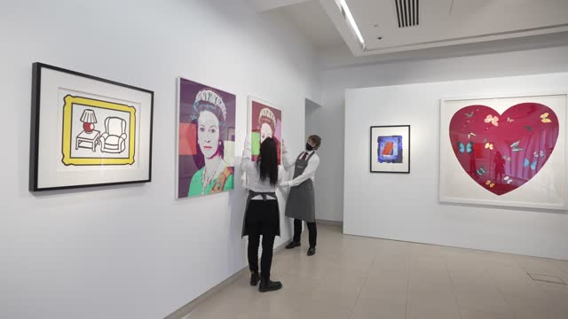 queen margarethe ii of denmark', '$', 'queen elizabeth ii' by andy warhol, 'red lamp' by roy lichtenstein, 'big love' by damien hirst on display... - currency symbol stock videos & royalty-free footage
