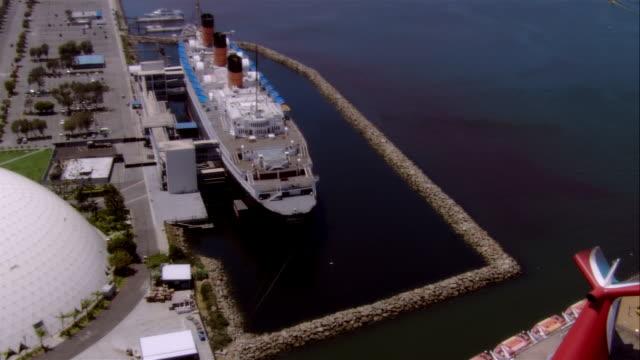aerial, rms queen mary in commercial dock, long beach harbor, california, usa, cu - long beach california video stock e b–roll