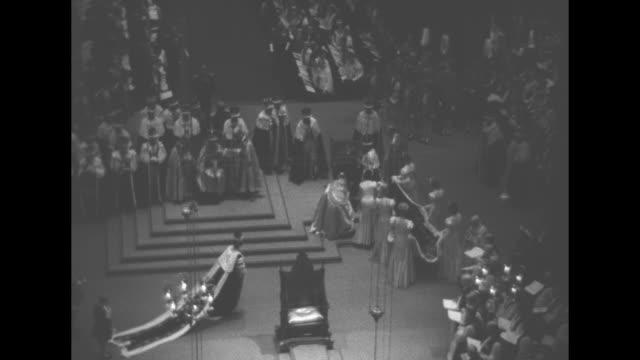queen mary in the royal box at the coronation of her son king george vi she stands with princesses elizabeth and margaret and mary princess royal /... - coronation stock videos and b-roll footage