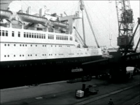 'queen mary' liner docks in cherbourg france cherbourg of cunard ocean liner rms queen mary steaming in dock quayside view 'queen mary' in dock... - la manche stock videos and b-roll footage