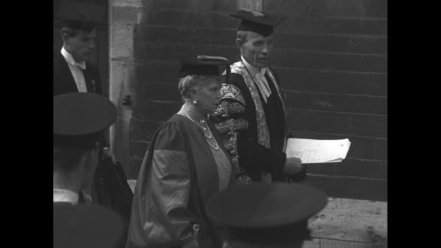 queen mary walks with edward wood lord halifax who is chancellor of the university of oxford and others to lay the cornerstone for the bodleian... - oxford university stock videos & royalty-free footage