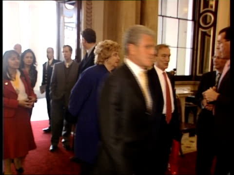 queen meets arsenal footballers at buckingham palace; england: london: buckingham palace: int david dein arriving with woman / members of the arsenal... - sportlerin stock-videos und b-roll-filmmaterial