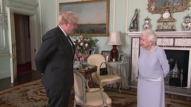 queen meets boris johnson in person for first time since march 2020; england: london: buckingham palace: int boris johnson mp stands talking with... - talking stock videos & royalty-free footage