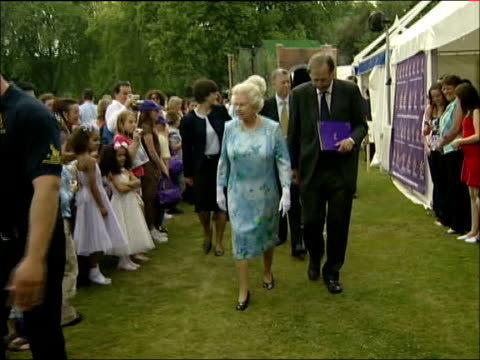 Queen meets children and dignitaries at party / Queen's speech Queen walks past stalls in grounds and takes gifts from well wishers and chats to...