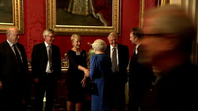 queen meets dame helen mirren at reception; england: london: buckingham palace: ext / night dame helen mirren posing for photocall on palace steps... - helen mirren stock videos & royalty-free footage