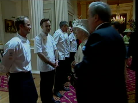 queen meets 'great british menu' chefs at mansion house; england: london: mansion house; int 'great british menu' chefs waiting for queen after meal... - british royalty stock videos & royalty-free footage