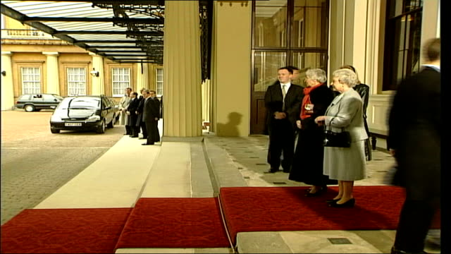 queen meets hungarian president ferenc madl england london buckingham palace ext car along ferenc madl wife out from car greeted by queen elizabeth... - eastern european culture stock videos & royalty-free footage