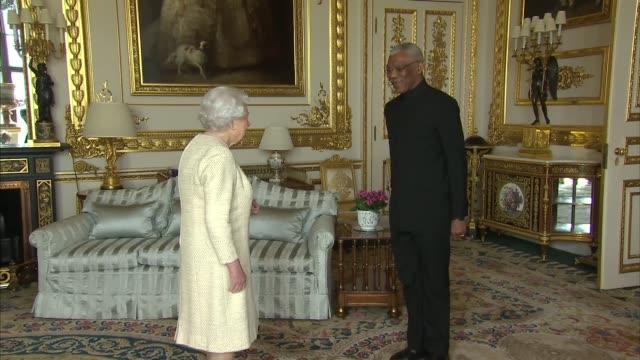 queen meets president of guyana at windsor; england: berkshire: windsor: windsor castle: int queen elizabeth ii greeting david a. granger / both... - guyana stock videos & royalty-free footage