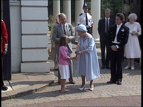 london clarence house queen mother out of clarence house coldstream guards play 'happy birthday' to her as marching past children giving her flowers... - 90th birthday stock videos and b-roll footage