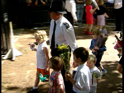 queen mother 98th birthday; nat: england: london: clarence house: ext gates of clarence house opening and queen mother wearing pale yellow coat and... - prince stock videos & royalty-free footage