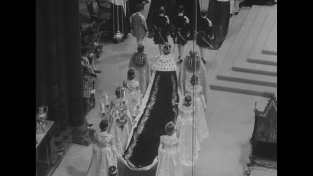 Queen Mother and Prince Charles stand in box / Elizabeth slowly walks away from camera flanked by two clergymen and followed by six Maids of Honor...