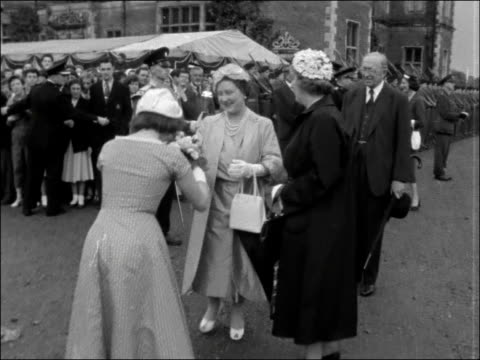queen mother at 'festival of youth' england hertfordshire hatfield hatfield house and crowd orangeseller in period costume crowds sheltering from... - hatfield stock videos and b-roll footage