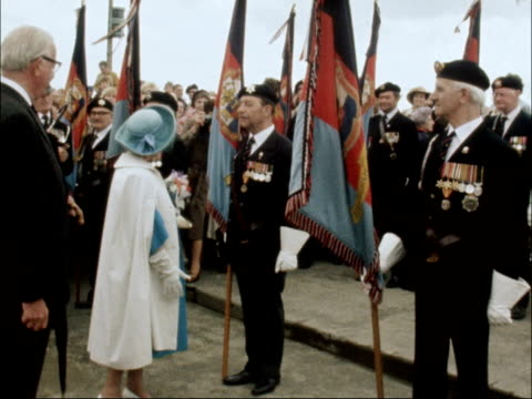 queen mother attends dunkirk veterans' association memorial service england kent ramsgate ext queen mother wearing rain mac over blue suit and hat as... - ramsgate stock videos & royalty-free footage