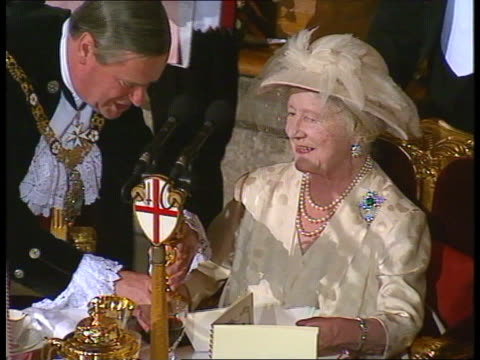 London Guildhall Queen Mother seated at birthday luncheon presented with clock guests choir singing 'Happy Birthday'
