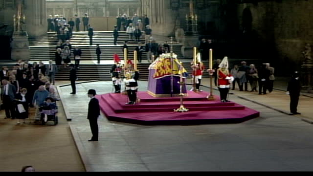 coffin lying in state in westminster hall; england: london: westminster palace: westminster hall: lms coffin of queen elizabeth, the queen mother... - lying on side stock videos & royalty-free footage