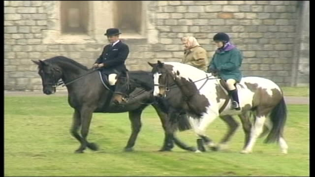 coffin moved to london; england: berkshire: windsor: ext the queen, princess royal & another along on horseback r-l / all along on horseback ditto l-r - all horse riding stock videos & royalty-free footage