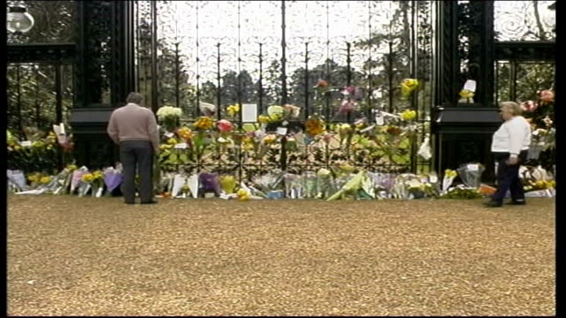 coffin moved to london england norfolk sandringham floral tributes on iron gates of sandringham pull out people milling about looking at flowers... - queen dowager stock videos and b-roll footage