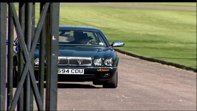 prince philip and queen driving in windsor england berkshire windsor ext prince philip duke of edinburgh driving car along past out from grounds of... - elizabeth ii stock videos & royalty-free footage