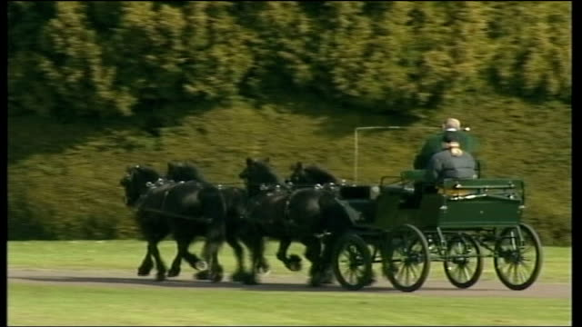 Prince Philip drives pony and trap in Windsor ENGLAND Berkshire Windsor Castle Prince Philip Duke of Edinburgh along on pony and trap SIDE Prince...