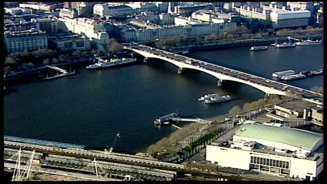 westminster aerials; england: london: ext air view - tracking shot the london eye and riverboats along on thames passing over national theatre, air... - river thames stock videos & royalty-free footage
