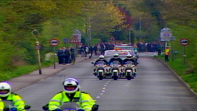 1325 1430 england berkshire gv cortege towards along road leading to windsor people milling around next river thames gv cortege towards along almost... - queen dowager stock videos and b-roll footage