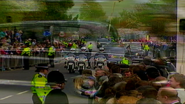 1325 1430 england berkshire windsor tgv royal household lined up seen thru king henry viii gate ls cortege towards with crowd in f/g hearse towards... - berkshire england stock videos and b-roll footage