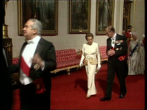 Queen Mother in hospital MS Queen along in long white dress and tiara followed by Duke of Edinburgh and Queen Mother as chats Dr John Habgood...