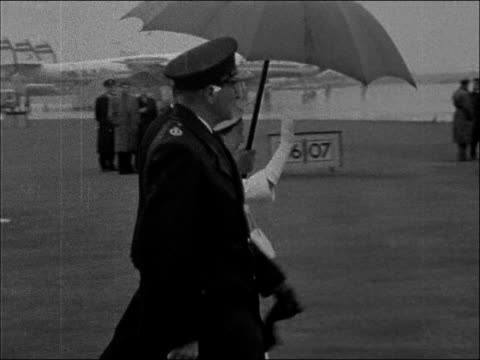 queen mother in southern rhodesia and nyasaland england london c plane taxis in princess margaret walks to plane under umbrella she waves queen... - 1957 stock videos & royalty-free footage