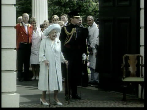 Queen Mother leaves for Scotland LIB London Clarence House EXT Queen Mother outside Clarence House with other members of the Royal Family on her...