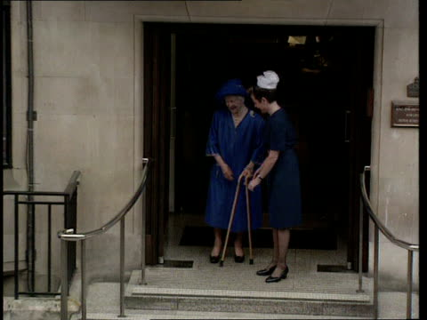 queen mother leaves hospital england london ms queen mother towards using two walking sticks as coming out of hospital lms more ditto with nurse... - nurse waving stock videos & royalty-free footage