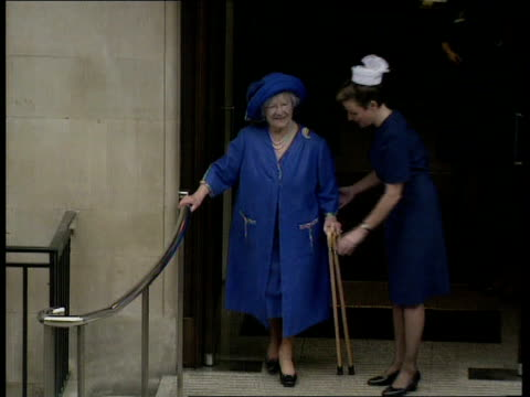 queen mother leaves hospital **** for england ms queen mother towards using two walking london sticks as coming out of hospital and stops smiles and... - nurse waving stock videos & royalty-free footage