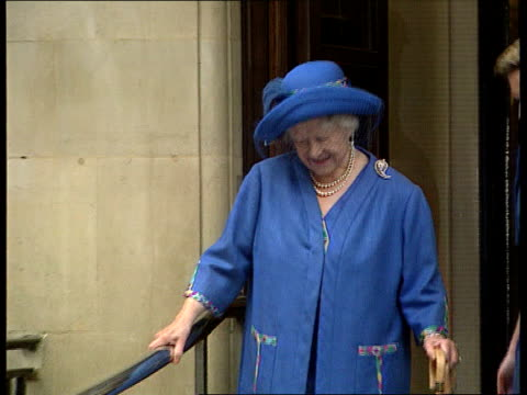 queen mother leaves hospital pool england london ms queen mother towards using two walking sticks as coming out of hospital and stops smiles and... - nurse waving stock videos & royalty-free footage