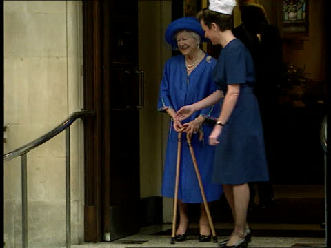 queen mother leaves hospital pool england london ms queen mother towards using two walking sticks and out through door and waves zoom in as smiling... - nurse waving stock videos & royalty-free footage