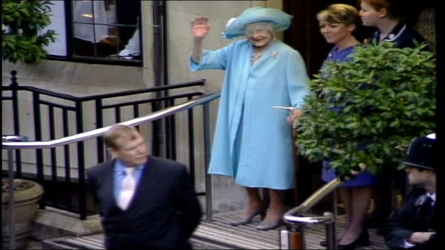 various views pool england london king edward vii hospital queen mother out thru doors of hospital and stands on top step waving to press / tls queen... - nurse waving stock videos & royalty-free footage