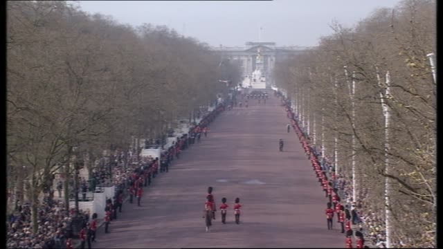 queen mother lying in state special: 10.00 - 11.00:; england: london: gvs members of raf marching along tgvs band leading procession along pall mall... - royal marines stock videos & royalty-free footage