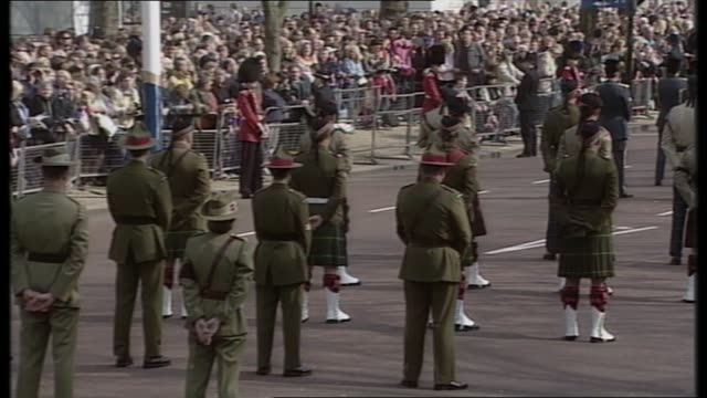 1000 1100 england london tgv military procession lined up in mall commonwealth regimental representatives standing waiting in procession tgv... - queen dowager stock videos & royalty-free footage