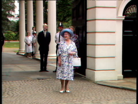 queen mother watches while marching band passes in front of camera 88th birthday celebrations clarence house; 04 aug 88 - エリザベス・ボーズ=ライアン点の映像素材/bロール